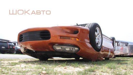Автомобиль вверх колесами