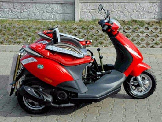 Трехколесный скутер Handiscoot для инвалидов