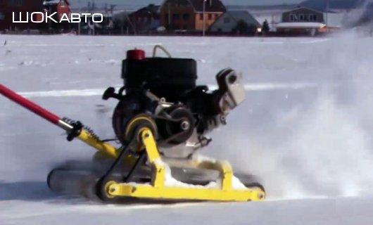 Толкающий буксировщик лыжника Тизер